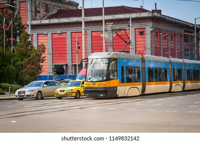 SOFIA, BULGARIA. A modern tram streetcar at the crossroad in the central Sofia stock image. Traffic in Sofia concept image.