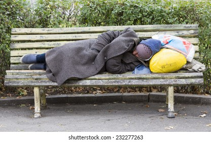 Sofia, Bulgaria - November 4, 2014: Homeless man is sleeping on a bench in the center of Sofia. Years after joining the EU Bulgaria is still the poorest country in the union.