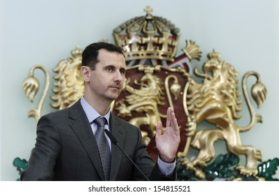 SOFIA, BULGARIA - NOVEMBER 9: Syrian President Bashar al-Assad speaks at a news-conference in Bulgaria's Presidents' office backdropped by Bulgarian national emblem on November 9, 2010.