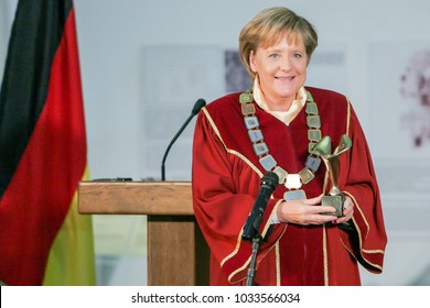 Sofia, Bulgaria - October 11, 2010: German Chancellor Angela Merkels smiles as she receives the doctor honoris causa title from Ruse University President Hristo Beloev (not in picture).