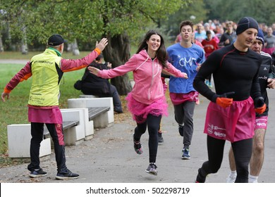 Sofia, Bulgaria - October 15, 2016: Participants are running dressed in pink skirts during a 5 km sprint. The run aims to raise breast cancer awareness and to motivate women to exam for the disease.