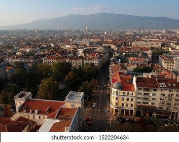 Sofia, Bulgaria october 2019. Aerial view (drone photography) of capital at the morning sun. Pictured are the military club, the beautiful buildings around it the Crystal Garden and Vitosha Mountain.