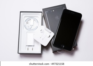 SOFIA, BULGARIA - OCTOBER 7, 2016: New Apple iPhone 7 Plus Jet Black unboxing, on white background, illustrative editorial.
