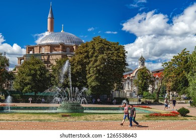 Sofia, Bulgaria - September 12, 2017: Tourists walk around Banski Square and enjoy the view of Banya Bashi, famous ornate mosque with a large dome, dating back to the 16th century in Ottoman Empire