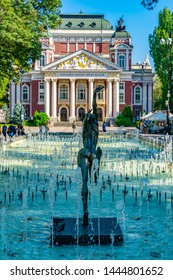 SOFIA, BULGARIA, SEPTEMBER 2, 2018: People are enjoyingg sunny summer day next to the fountain in front of the Ivan Vazov theatre in Sofia, Bulgaria