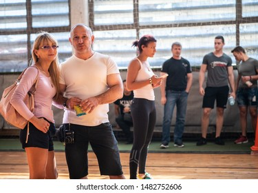 Sofia, Bulgaria - September 23, 2018: A group of bulgarian powerlifting competitors are waiting in the public for their attempts at Bulgarian National Powerlifting Championship Competition.