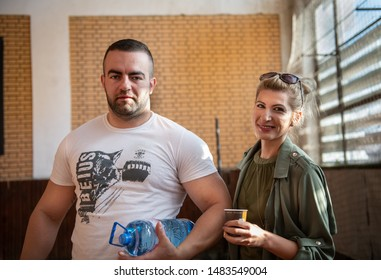 Sofia, Bulgaria - September 23, 2018: They are happy couple in love, powerlifter boy and powerlifting girl champions, hugging and kissing at Bulgarian National Powerlifting Championship Competition.
