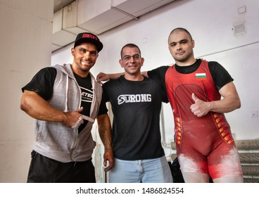 Sofia, Bulgaria - September 23, 2018: Ex-powerlifter and nowadays bodybuilder is supporting his powerlifting brother at Bulgarian National Powerlifting Championship Competition.