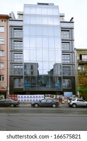 SOFIA, BULGARIA - SEPTEMBER 28: Modern building with large glass front, advertisements and reflections on Kniaginya Maria Louise Blvd, on September 28, 2013 in Sofia, Bulgaria