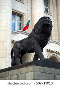 Sofia Bulgaria statue lion Court of Justice with Bulgarian national flag in window