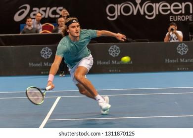 SOFIA - FEBRUARY 07.2019: Stefanos Tsitsipas(GRE) plays at the ATP Sofia Open tournament in Sofia, Bulgaria on February 05, 2019 - Image