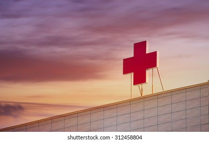 SOFIA - SEPTEMBER 02 , 2015 : Sunset over the medical red cross on the top of the popular hospital Pirogov in Sofia, Bulgaria