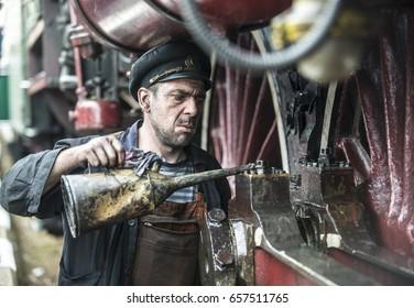 Sofia,Bulgaria - May 24, 2017 : Mechanic prepares a steam locomotive for a tourist trip