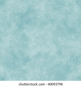 Soft abstract pattern in blue.  Distressed background with paper grain texture.