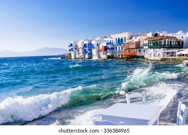 Soft afternoon light and breaking waves in a famous Little Venice quarter of Mykonos town, Mykonos island, Greece