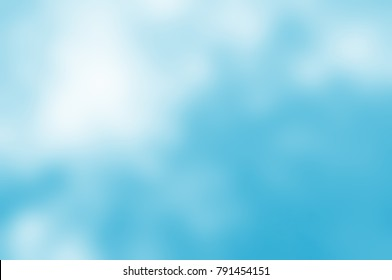 Soft background blur from photograph.  Bright, light blue hues dappled and blended with a burst of white sunlight.