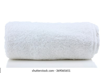 soft bath towel rolled up on a white isolated background