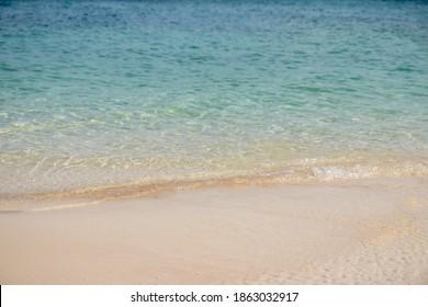 Soft beautiful ocean wave on sandy beach.