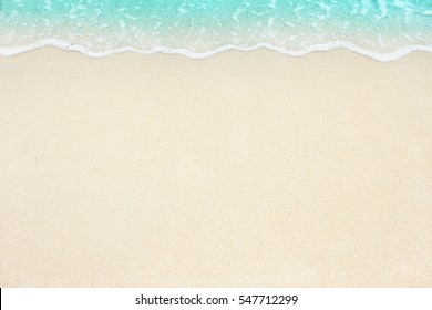 Soft beautiful ocean wave on sandy beach. Background.