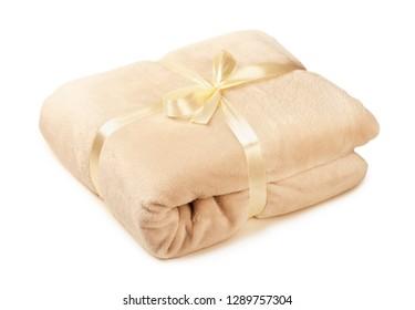 Soft beige fleece blanket gift, folded isolated on a white background