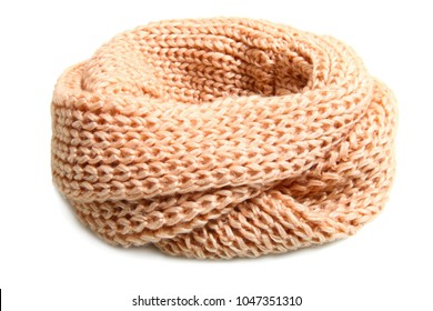 Soft beige knitted scarf isolated on white background.