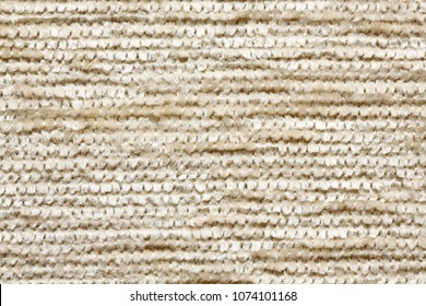 Soft beige material texture with clean surface. High resolution photo.