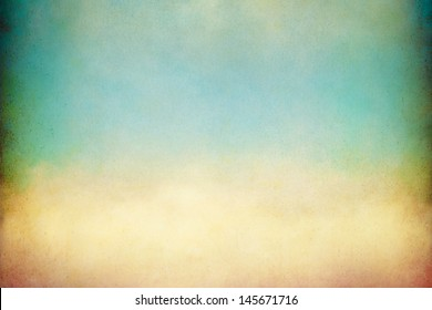 A soft, billowing cloud with vintage colors and textures.  Image displays a pleasing paper grain visible at 100 percent.