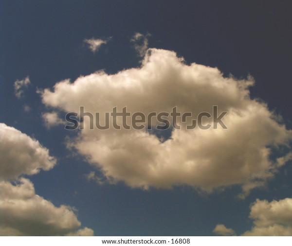 a soft, billowy, doughnut of a cloud