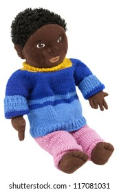 Soft black doll with homemade knitted woolen clothes