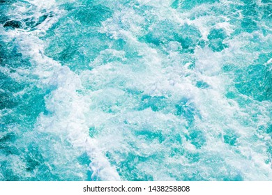Soft blue colored sea foams and waves