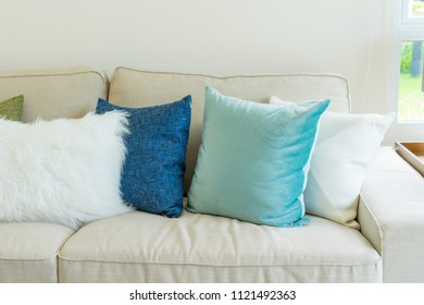 soft blue cushion on light grey sofa in living room
