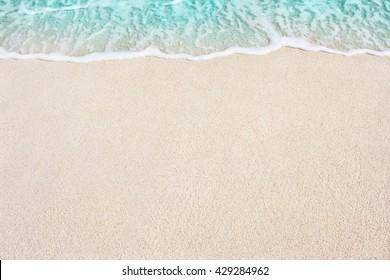 Soft Blue Ocean Wave On Sandy Beach. Background. Selective focus.