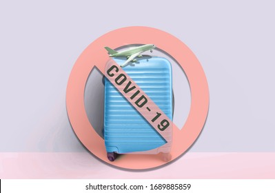 """Soft blue suitcase standing with """"no entry sign"""" and message . Stop travel to risk places COVID-19. prevention of contagion. Coronavirus crisis in travel and tourism industry concept"""