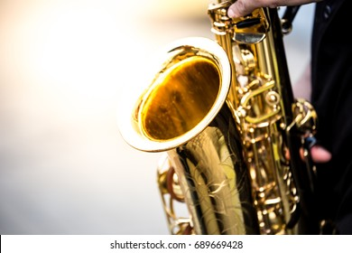 soft and blur focus.saxophonist playing saxophone in jazz music.concept for live music festival.Instrument on stage,fashion,abstract musical background.street musician.