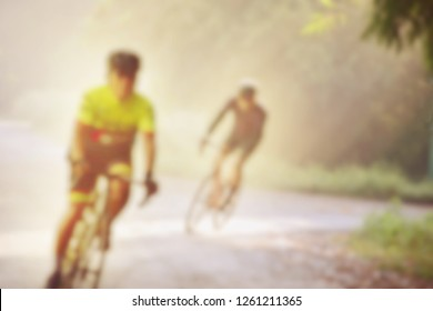Soft blur peple exercise with cycling in park