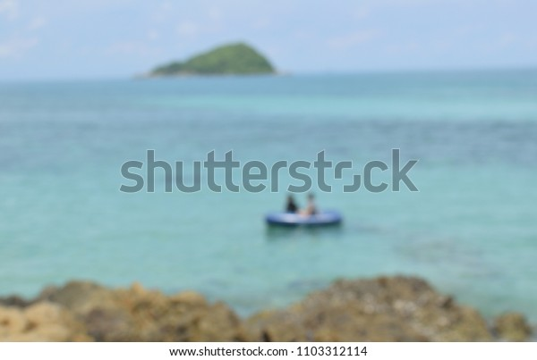 Soft and blurred focus people on a rubber boat in the sea for background.