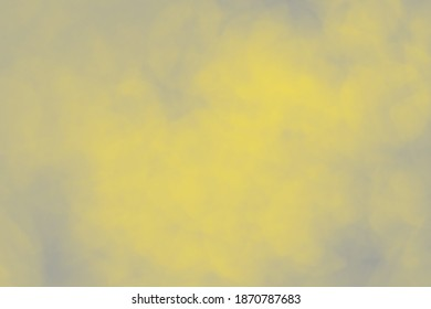 Soft blurred pastel background colored in gray and yellow colors.