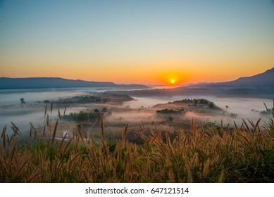 soft blurred photo sun rises in the morning view point with mountain mist in Khao Takhian Ngo at khao kho is  most famous travel place in thailand