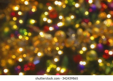 soft bokeh christmas lights background colours of rich warm amber red green