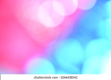 Soft bokeh lights on a pink and blue background. Ideal for concepts: party, festive, happy, fun, brightness, vibrancy