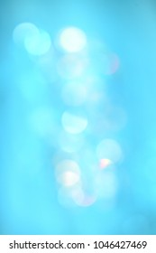 soft bokeh lights on turquoise background