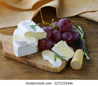 Soft brie cheese on a wooden board