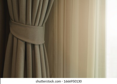 soft brown curtain with morning light from window bedroom background