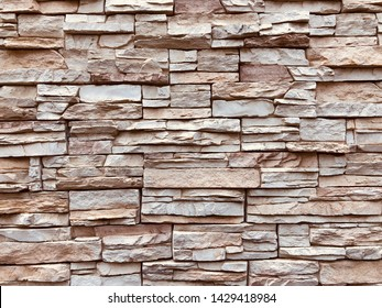 Soft brown stone block wall