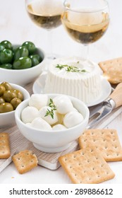 soft cheeses, crackers and pickles for wine, vertical, top view, close-up