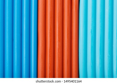 Soft clay from briquettes of cyan, brown and blue for modeling. Plastic colorful material for children art education. Close-up full screen, texture. Harmonious colors
