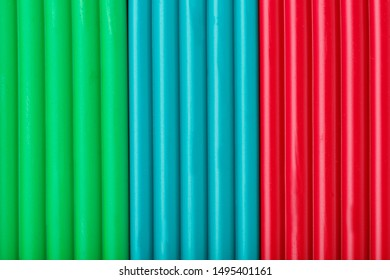 Soft clay from briquettes of green, blue and red color for modeling. Plastic colorful material for children art education. Close-up full screen, texture. Harmonious colors
