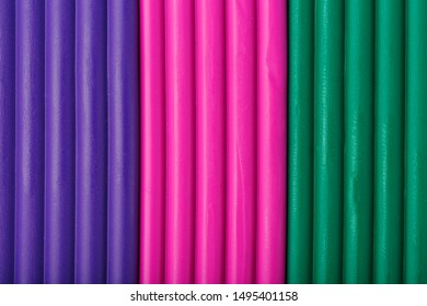 Soft clay from briquettes of violet, magenta and green for modeling. Plastic colorful material for children art education. Close-up full screen, texture. Harmonious colors