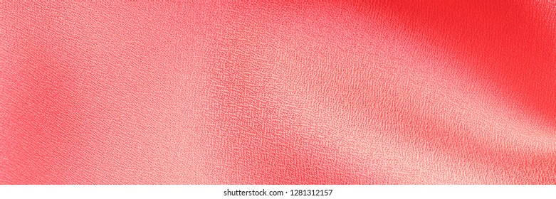 Soft cloth background, banner. Living Coral color Soft silk cloth textile background. Living Coral satin texture. Color 2019 year concept.