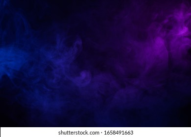 Soft clouds of colorful smoke dark abstract backgound